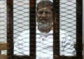 Trial of Morsi, 10 others on espionage charges postponed to Sat.