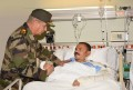 Defense min. checks on patients at military hospitals