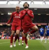 Salah, Mane strike to keep Liverpool top with Chelsea win
